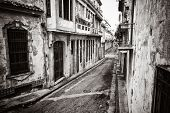 Grunge monochromatic image of a decaying buildings in Old Havana