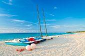 Sailing boats and water bikes in the beautiful cuban beach of Varadero