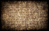 Ancient grunge cuneiform assyrian or sumerian inscription on a clay tablet