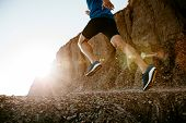 Healthy Lifestyle Middle Aged Man Runner Running On Mountain Trail In Sunset poster