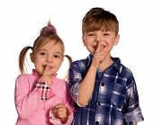 shhh... Funny little boy and girl. Good for borders of articles or websites. Beautiful caucasian mod