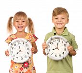 Child holding big clock isolated on white background