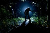 Siluette of man in the forest on the night