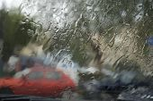 stock photo of car-window  - Inside view from car while driving in rainy weather conditions in the city - JPG