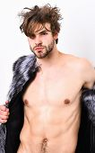 Guy Attractive Fashion Model Posing Fur Coat On Naked Body. Fashion And Pathos. Fashion Concept. Ric poster