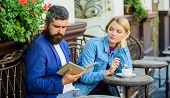 Man With Beard And Blonde Woman On Romantic Date. Common Interests. Couple In Love Sit Cafe Terrace. poster