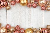 Christmas Double Border Of Rose Gold And Golden Ornaments On A Rustic White Wood Background poster