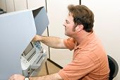 Man Votes On Touch Screen