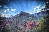 Sunrays behind the mountains in Arizona poster