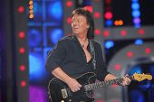 MOSCOW - DEC 17: Chris Norman playing guitar during concert of Legend RetroFM in Sports complex Olim