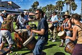 CARLSBAD, CALIFORNIA - SEPTEMBER 2: A multitude of drummers gather for a joyous rhythmic drumming ce