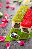 Tobiko Spicy Maki Sushi - Hot Roll Topped with various type of Tobiko (flying fish roe). Tuna, Cucum