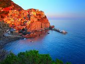 Manarola town at sunset. Cinque Terre national park. Italy