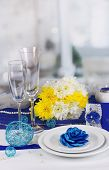 Serving fabulous wedding table in purple and blue color of the restaurant background