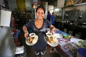 CHANG, THAILAND - JANUARY 23:  Unknown vendors prepare food at a street side restaurant on Jan 23, 2