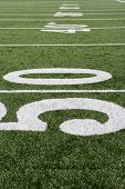 50 yard line on American football field with artificial turf