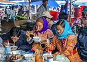 Hmong People Eating On Sunday Market.