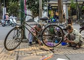 Bike Repair Business On A Corner Of The Street.