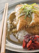Plated Tonkatsu With Vinegar Ricecurry Sauce And Pickled Red Radish