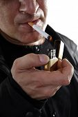 stock photo of smoker  - Smoker is lighting cigarette - JPG