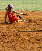 stock photo of fastpitch  - a fast pitch softball player sliding into second base - JPG