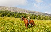 Happy girl riding a horse