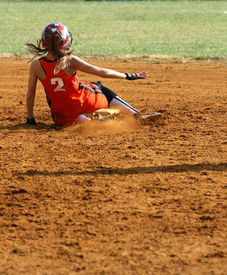 picture of fastpitch  - a fast pitch softball player sliding into second base - JPG