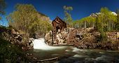 Scenic panorama of Crystal Mill in Colorado showing the historical power house perched on a rocky ou