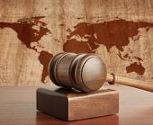Wooden gavel on a background map of the world