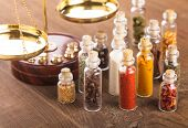 image of vedic  - Little bottles with spices and scales on the table vedic cuisine - JPG