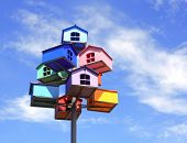 stock photo of nesting box  - Colorful nesting boxes on blue sky - JPG