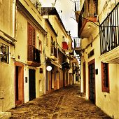 view of a typical street of Dalt Vila, the old town of Ibiza Town, in Balearic Islands, Spain, with a retro effect