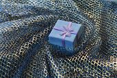 Gift Box On A Background Drapery
