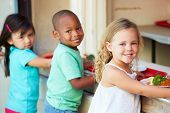 stock photo of playground school  - Elementary Pupils Collecting Healthy Lunch In Cafeteria - JPG