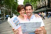 Couple looking at map in La Rambla de Barcelona