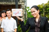 Real estate market - young Indonesian couple looking for real estate apartment or house to rent or buy