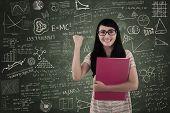 Happy Female Student In Class On Written Board