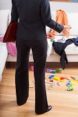 Businesswoman Surprised Mess At Home