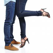 stock photo of denim jeans  - Close up of a cuddling couple legs isolated on a white background - JPG