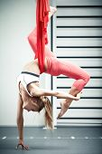 picture of gravity  - Young woman making antigravity yoga exercises - JPG