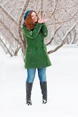 Pretty Girl Catches Snow By Palms Outdoor At Winter Day In Park