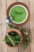 image of nettle  - Nettle cream soup on wooden background - JPG