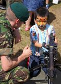 A British Army solidier and boy at the Bristol Balloon Fiesta, UK 8/8/09