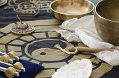 An Arrangement Of Tibetan Singing Bowls, Tingsha And Tuning Forks For Holistic Healing.