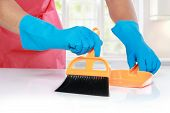 Hand With Glove Using Cleaning Broom To Clean Up