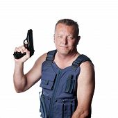 Causasian Male With Gun And Kevlar Vest