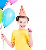 Portrait of happy smiling girl in yellow t-shirt holding colorful balloons - isolated on a white.