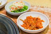 picture of kimchi  - Kimchi korea food on the table beside barbecue stove - JPG