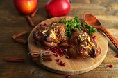 stock photo of quail  - Roasted quails  on cutting board - JPG