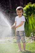Boy, Splashing Water With A Hose, Having Fun